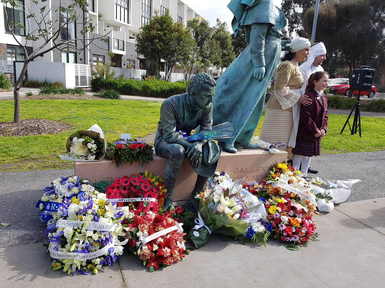 Wreaths laid at the foot of the memorial